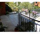 Zöld övezeti két generációs sorházi lakás dupla garázzsal ELADÓ a XII. kerületben